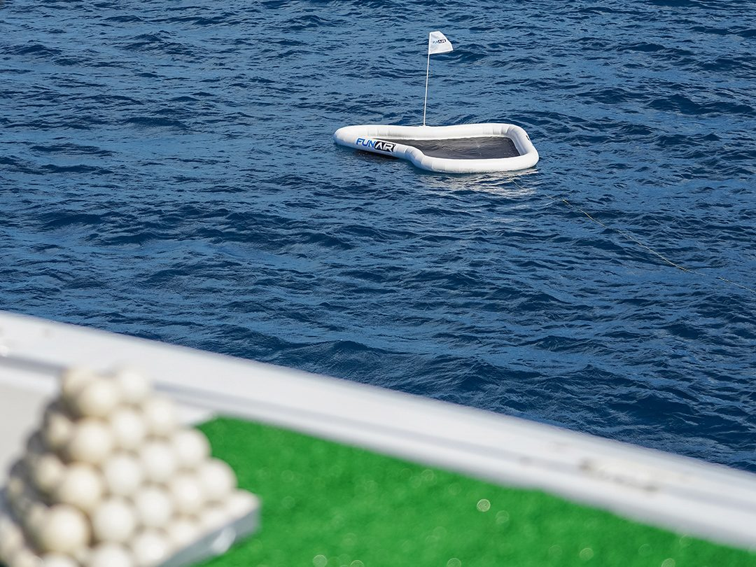 Inflatable floating Yacht Golf Green with a flag