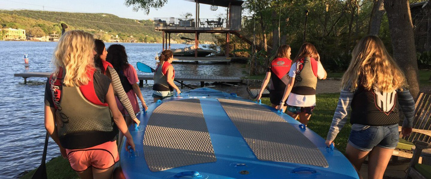 Group using a large inflatable SUP