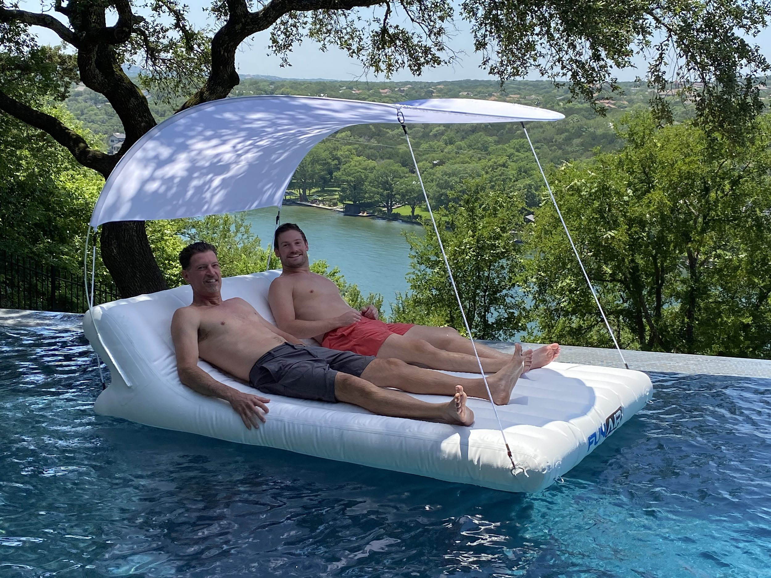 Floating inflatable double shaded lounger