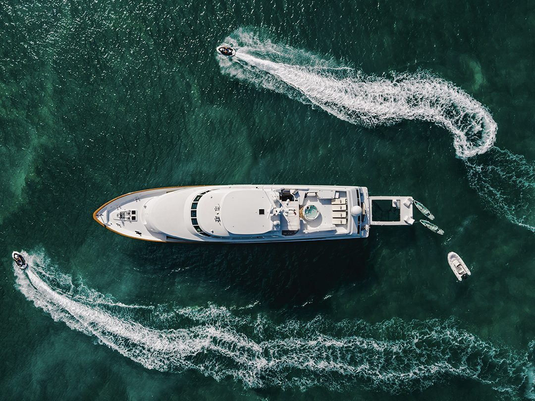 Overhead view of Superyacht Crescendo IV with FunSize Beach Club Sea Pool and Superyacht Wave Chairs